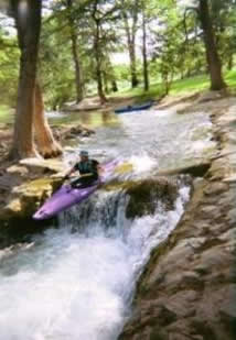 Kayak over waterfall on Medina River